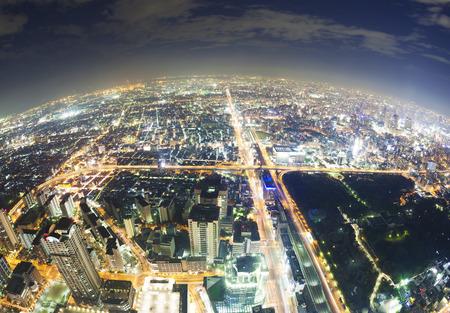 Aerial fisheye view of buildings in Osaka in Japan at night Stock Photo