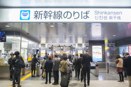 Osaka, Japan - Nov 1: Commuters going through the ticket gates in a Shinkansen bullet train station in Japan on Nov 1, 2014. The Shinkansen is a netwrok of high-speed railway lines in Japan.