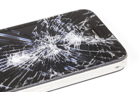 display retina: Adelaide, Australia - Dec 8: Studio shot of an iPhone 4 with seriously broken retina display screen isolated on white on Dec 8, 2014. iPhone 4 is a smartphone developed by Apple Inc.