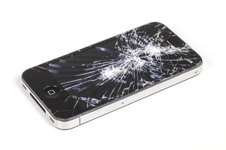 retina display: Adelaide, Australia - Dec 8: Studio shot of an iPhone 4 with seriously broken retina display screen isolated on white on Dec 8, 2014. iPhone 4 is a smartphone developed by Apple Inc.