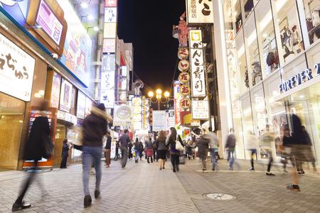 tourist destinations: Osaka, Japan - Oct 28: Tourists visiting Dotonbori in Osaka, Japan at night on Oct 28, 2014.  Dotonbori is one of the principal tourist destinations in Osaka, Japan. Editorial