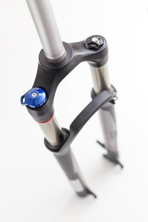 Generic mountain bike suspension fork on white background photo