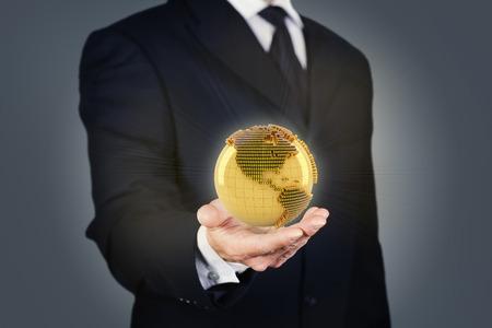 golden globe: Composite image of a businessman holding a golden globe Stock Photo