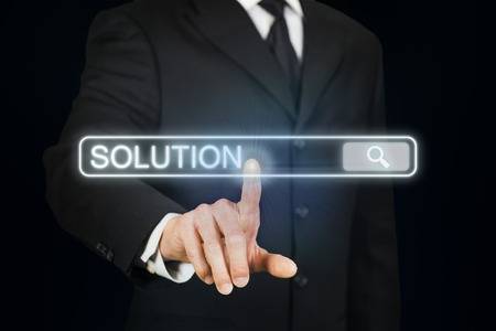 clicking: Businessman clicking search field with solution as keyword Stock Photo