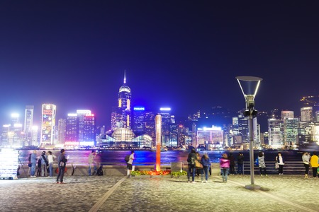 finanical: Hong Kong, China - November 25, 2013: View of Victoria Harbour in Hong Kong from Kowloon waterfront. The Victoria Harbour is world-famous for its stunning panoramic night view and skyline, and is a popular tourist attraction in Hong Kong.