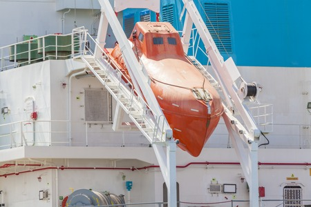 marine industry: Close-up view of a totally enclosed freefall lifeboat on a downward sloping slipway Stock Photo