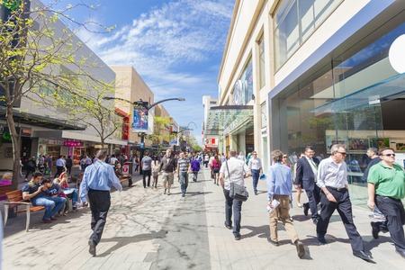Adelaide, Australia - September 23, 2013: People walking along Rundle Mall in Adelaide, South Australia. Rundle Mall is the premier retail area of South Australia and a popular tourist attraction.