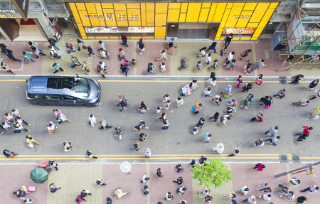 aerial views: Hong Kong, China - October 19, 2013: Pedestrians walking on a street in Causeway Bay, Hong Kong. Causeway Bay is a major shopping district, and one of the most crowded area in Hong Kong.