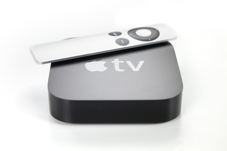 tv: Adelaide, Australia - January 27, 2015: View of a third generation Apple TV and its remote control. The Apple TV is a digital media player developed by Apple Inc.