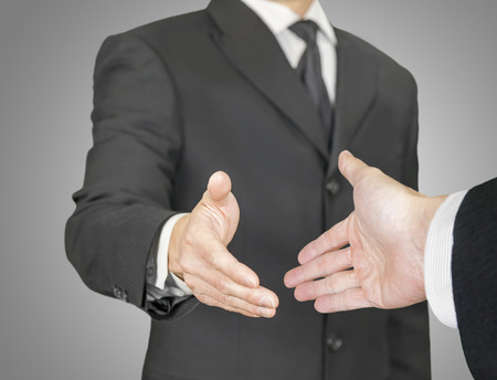 point of view: Businessmen having a handshake, point of view composition
