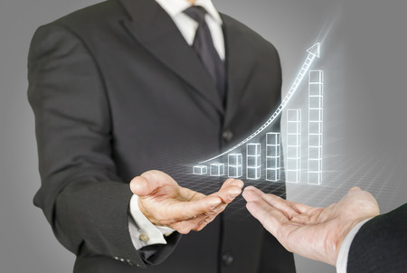 financial success: Composite image of businessmen with a rising chart in wireframe mode, point of view composition