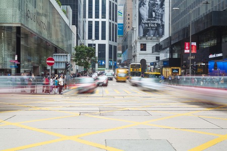 Hong Kong, China - November 19, 2013: Busy intersection in Central, Hong Kong. Central is the central business district in Hong Kong, with many headquarters of multinational financial coperations in the area. Editorial