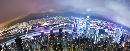aerial view city: View of Victoria Harbour in Hong Kong from the Peak, long exposure with light trails of moving ships