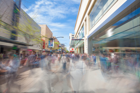 People walking along Rundle Mall in Adelaide, South Australia, with motion blur