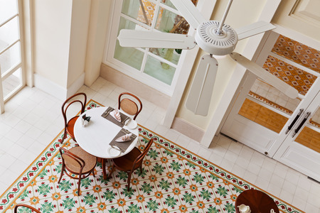 dinning table: Interior of a restaurant, with dinning table and chairs Editorial