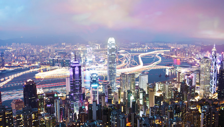 finanical: View of Victoria Harbour in Hong Kong from the Peak, long exposure with light trails of moving ships