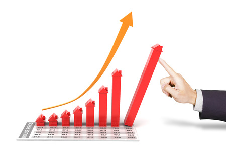 real estate growth: Hand of businessman supporting a 3d rendered rising chart representing the growth of real estate market Stock Photo