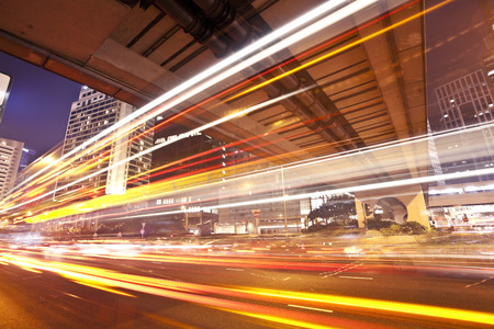 hk: Traffic trails of double decker traveling on a busy road in Hong Kong Stock Photo