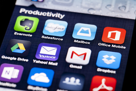 dropbox: Adelaide, Australia - July 5, 2013: Close-up image of an iPhone screen with icons of productivity apps Editorial