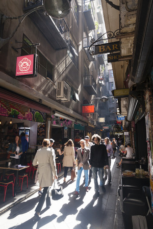 outdoor cafe: Melbourne, Australia - April 2, 2015: People visiting the Centre Place in Melbourne, Australia. It is a busy laneway in Melbourne CBD, with bars, cafes and restaurants. Editorial