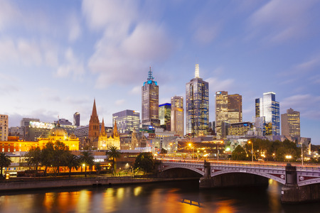 cbd: Melbourne, Australia - April 2, 2015: View of modern buildings in Melbourne CBD at sunset Editorial