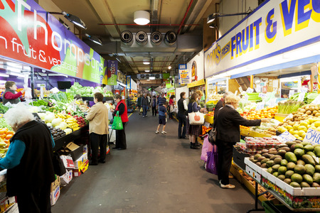 market place: Adelaide, Australia - September 14, 2012: People shopping inside the Adelaide Central Market , which is a popular tourist attraction and large multicultural market in Adelaide, Australia.