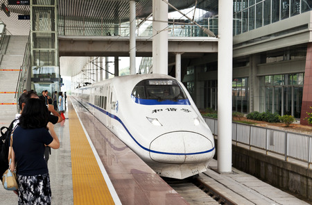 bullet train: Shaoguan, China - September 26, 2011: CRH High-speed train (Gaotie) arriving at Shaoguan Railway Station