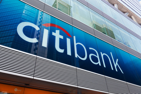 bank branch: Hong Kong, China - August 13, 2011: Citibank sign and logo in front of the bank in Mongkok, Hong Kong, with reflection of financial buildings. Citibank is a major international bank.