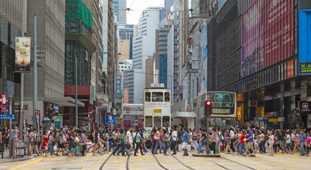 Hong Kong, China - August 21, 2011: Pedestrians crossing a busy crosswalk in Central, Hong Kong. Stock Photo - 38954487