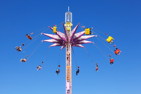 chairoplane: Adelaide, Australia - September 9, 2012: People riding on a chairoplane in the 237th Royal Adelaide Show, which is an annual agricultural show and fair held in Adelaide, South Australia