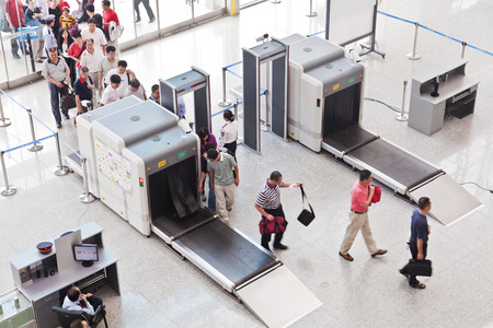 Guangzhou, China - September 26, 2011: Passengers queuing up for security check at Guangzhou South Railway Station