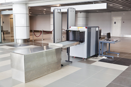 security: X-ray scanner and metal detector at airport security checkpoint