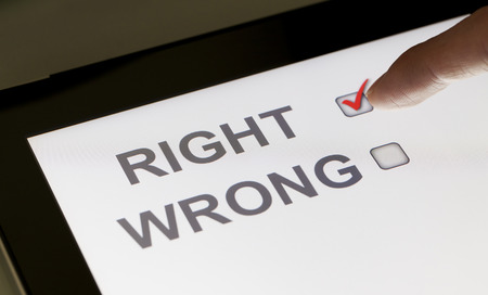 checkboxes: Right and wrong checkboxes on a tablet, clicking right Stock Photo