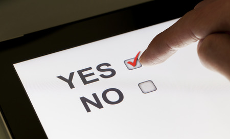checkboxes: Yes and no checkboxes on a tablet, clicking yes Stock Photo