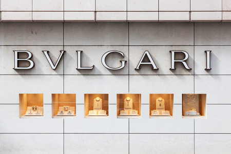 Hong Kong, China - August 21, 2011: Bulgari sign and window display outside a branch in Central, Hong Kong. Bulgari is an Italian jeweler and luxury goods retailer. It has several product lines including watches, handbags, fragrances, accessories, and hot