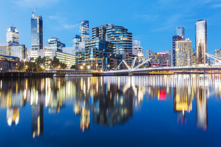 Cityspace of Dockland in Melbourne at sunset with reflection Standard-Bild
