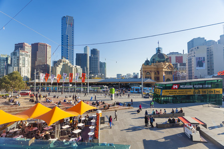 federation: Melbourne, Australia - April 30, 2015: View of people relaxing in a cafe at Federation Square and modern buildings in Melbourne, Australia Editorial