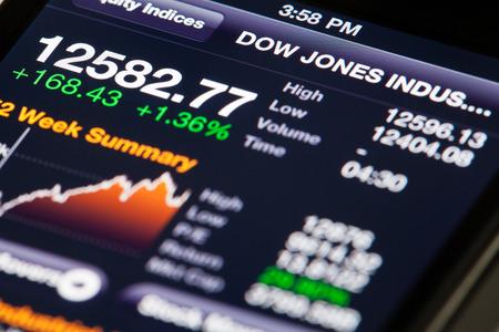 Hong Kong, China - July 2, 2011: iPhone running Bloomberg app, displaying Dow Jones Industrial Average data 報道画像