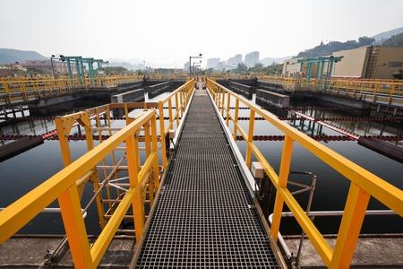 walkway: Steel walkway in a sewage treatment plant Stock Photo