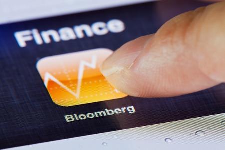 Hong Kong, China - July 2, 2011: Macro image of clicking the Bloomberg icon on an iPad screen