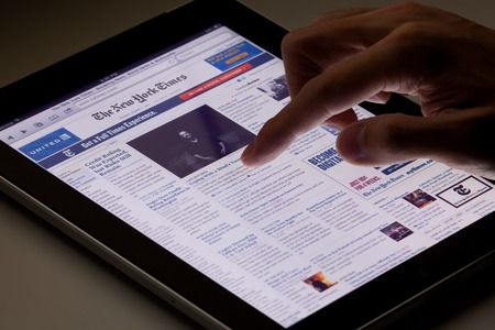 Hong Kong, China - August 7, 2011: Image of browsing the New York Times website using an ipad. The New York Times is a popular American daily newspaper and its website is the most popular American online newspaper website.