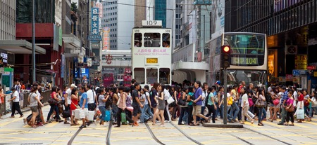 central: Hong Kong, China - August 21, 2011: Pedestrians crossing a busy crosswalk in Central, Hong Kong.