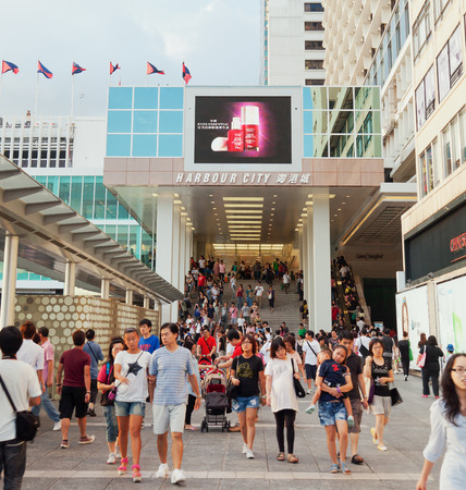 Hong Kong, China - August 21, 2011: Shoppers outside Harbour City, a shopping mall in Hong Kong. It is one of the most popular travel destination of mainland Chinese visitors.