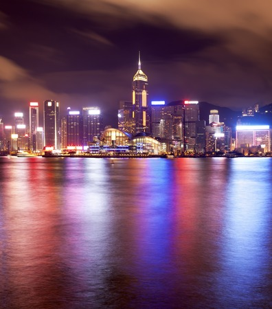 hk: View of the Victoria Harbour in Hong Kong at night