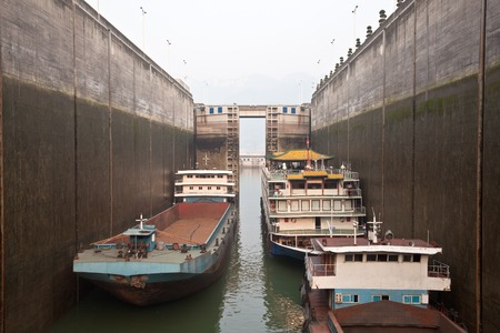 three gorges: Ships rising in the lock at Three Gorges Dam Stock Photo