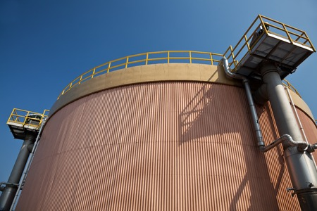 exchanger: Digestion tank and heat exchanger in a sewage treatment plant Stock Photo