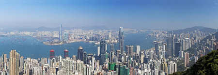 hk: Panorama of Victoria Harbour in Hong Kong from the Peak in daytime Stock Photo