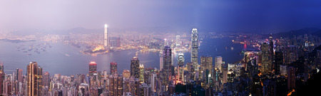 finanical: Panoramic view of Hong Kong from day to night Stock Photo