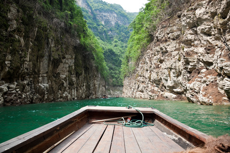 three gorges: Tourist boat sailing through the small three gorges, this region is the most beautiful of all the tributaries to the river length of the Yangtze River along the Three Gorges. Stock Photo
