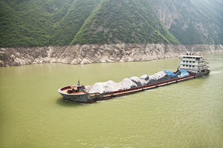 yangtze river: Coal barge sailing along the Three gorges region of Yangtze river in China